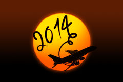 Neues Jahr 2014, das mit dem Flugzeug zeichnet Stockfotografie