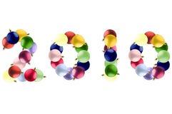 Neues Jahr gebildet von den bunten Weihnachtskugeln. Lizenzfreie Stockfotos