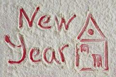 Neues Jahr 2017 geschrieben mit dargestelltem Haus auf das Mehl backgroun Stockbild