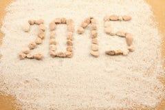 Neues Jahr geschrieben mit Kieseln Stockbild