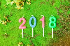 Neues Jahr 2018 Kerzen numerischer Text Lizenzfreie Stockfotos