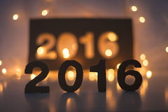 Neues Jahr, 2016, Lichter, Zahlen gemacht von der Pappe Lizenzfreie Stockfotos