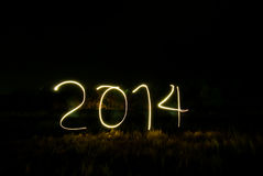 Neues Jahr 2014 machte vom wirklichen Licht Lizenzfreies Stockbild