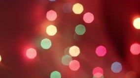 Neues Jahr ` s bokeh Neues Jahr Bokeh von den Lichtern einer Girlande Die Leuchten sind eingeschaltet Festliche Stimmung Abstrakt stock video footage