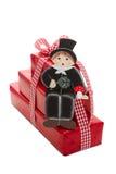 Neues Jahr wünscht mit Schornsteinfeger und einem Rot lokalisierten Geschenk Lizenzfreies Stockfoto