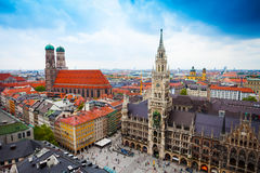 Neues Rathaus Glockenspiel, Frauenkirche Bavaria. Beautiful city centre view of Marienplatz, New Town Hall (Neues Rathaus), Glockenspiel, Frauenkirche with sky Royalty Free Stock Images
