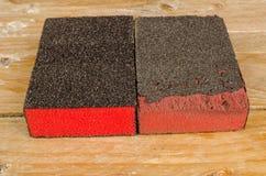 Neues und benutztes Sandpapier Lizenzfreie Stockbilder