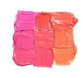 Neuf échantillons de différentes couleurs de rouge à lèvres sous forme de place Image stock