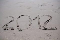 An neuf 2012 sur la plage Image libre de droits