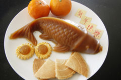 An neuf chinois heureux ! Photo stock