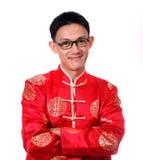 An neuf chinois heureux Jeune homme asiatique avec le geste du congratul Photo stock
