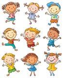 Neuf enfants heureux dansant ou sautant Photographie stock
