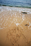 neufs heureux de plage écrivent l'an Image libre de droits
