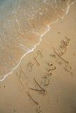 neufs heureux de plage écrivent l'an Photo stock