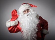 Neugierige Santa Claus lizenzfreies stockbild