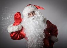 Neugierige Santa Claus stockbilder