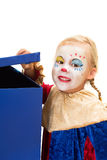 Neugieriger Clown mit Kasten Stockfotos