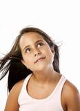 Neugieriges kleines Mädchen, das oben schaut Stockfoto