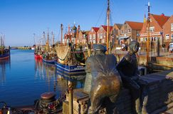 Neuharlingersiel harbour statuen Stock Photos