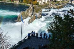 Neuhausen, Switzerland - October 16, 2017: Tourists watch the Rh. Ine waterfall from the site of the laufen castle Royalty Free Stock Images