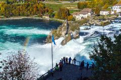 Neuhausen, Switzerland - October 16, 2017: Tourists watch the Rh. Ine waterfall from the site of the laufen castle Stock Image