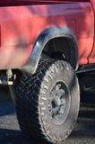 Neumático campo a través en el carro Fotos de archivo libres de regalías
