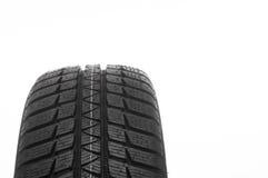 Neumático de coche aislado en el fondo blanco Foto de archivo