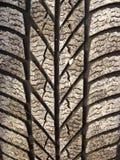 Neumático de coche con la arena Foto de archivo libre de regalías