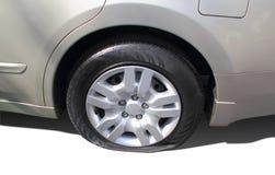 Neumático de coche trasero plano Imagenes de archivo