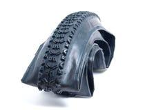 Neumático de la bici de montaña desinflado Imagen de archivo libre de regalías