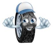 Neumático de la historieta del mecánico que da los pulgares para arriba Imagenes de archivo