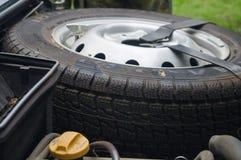 Neumático de repuesto debajo de la capilla Fotografía de archivo libre de regalías