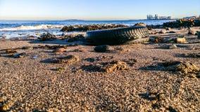 Neumático en la arena Imagen de archivo libre de regalías