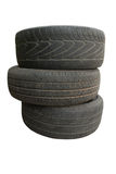 Neumático viejo, en los fondos blancos Imagenes de archivo