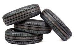 Neumáticos de coche aislados en el fondo blanco Fotos de archivo