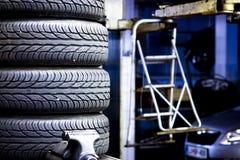 Neumáticos de coche empilados Foto de archivo libre de regalías