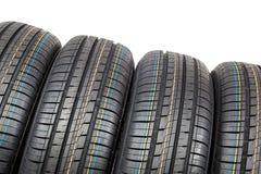 Neumáticos de coche en el fondo blanco Imagen de archivo libre de regalías