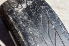 Neumáticos de coche llevados viejos Foto de archivo libre de regalías