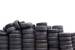 Neumáticos de coche usado aislados en el fondo blanco Foto de archivo libre de regalías