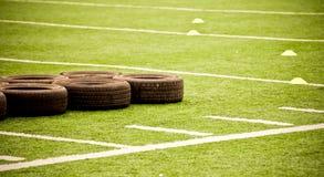 Neumáticos en campo de fútbol Imagen de archivo