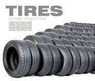 Neumáticos en el fondo blanco Imagen de archivo libre de regalías