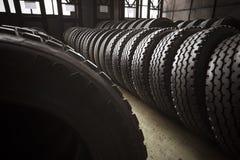 Neumáticos grandes de un garaje del autobús Imagen de archivo libre de regalías