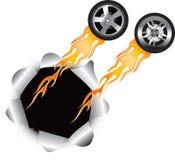 Neumáticos llameantes que salen del agujero Foto de archivo libre de regalías