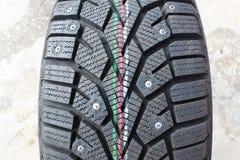 Neumáticos macros del invierno del coche del tiroteo Imagen de archivo libre de regalías