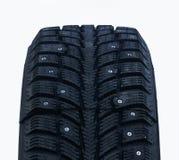 Neumáticos tachonados del invierno Fotografía de archivo libre de regalías