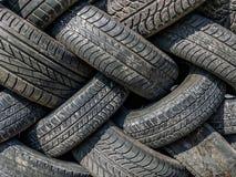 Neumáticos viejos y gastados Imagen de archivo libre de regalías