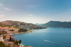 Neum city - turist resorts on hill with blue sky. The tourist resort of Neum, Bosnia Herzegovina on hil, with blue sky and light clouds. Malostonski bay on Stock Images