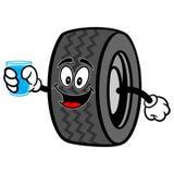 Neumático con la taza de agua Imágenes de archivo libres de regalías