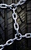 Neumático negro con el encadenamiento Imagen de archivo libre de regalías