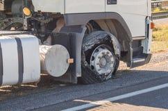 Neumático soplado del frente del camión Fotos de archivo